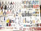 assorted tools, nailclippers,assorted swiss pocket knives