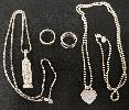 Tiffany & Co. snake chain, Mayan Cartouche Pendant, T&Co. rings